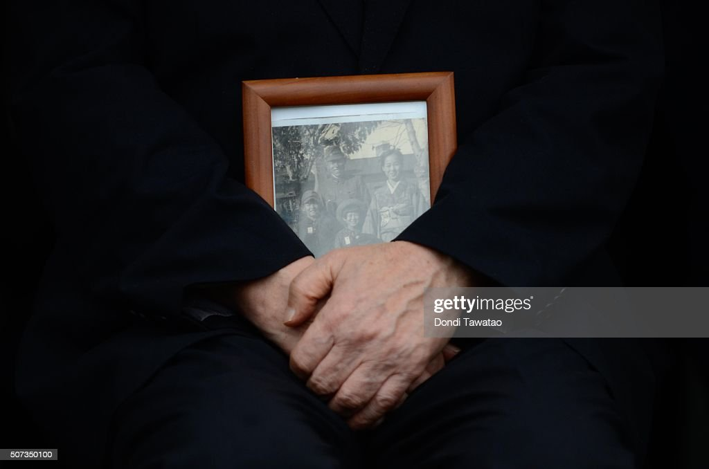 A surviving relative of Japanese soldiers of World War II hold a family photo during a solemn ceremony to honor fallen Japanese soldiers of World War II at the Japanese War Memorial Shrine at Caliraya on January 29, 2016 in Laguna, Philippines. The emperor and empress of Japan concludes their five-day state visit to the Philippines on Friday to highlight the 60 years of strong diplomatic ties between the two nations.