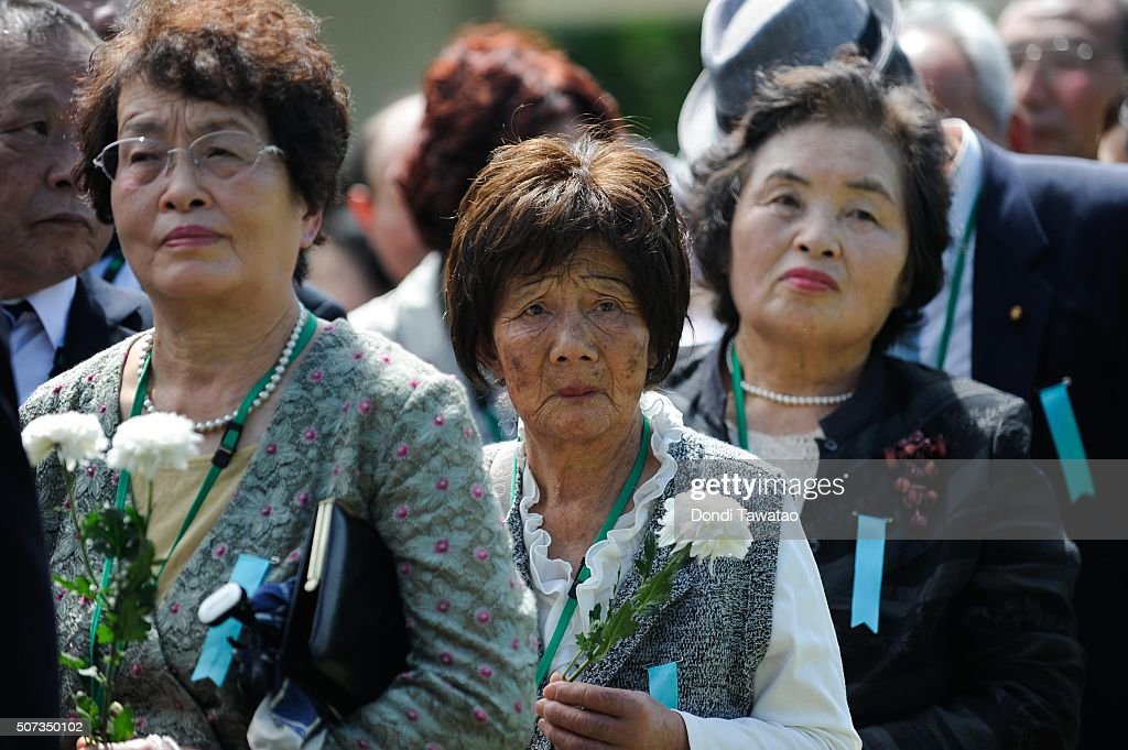 Surviving relatives and descendents of Japanese soldiers of World War II offer flowers during a solemn ceremony to honor fallen Japanese soldiers of World War II at the Japanese War Memorial Shrine at Caliraya on January 29, 2016 in Laguna, Philippines. The emperor and empress of Japan concludes their five-day state visit to the Philippines on Friday to highlight the 60 years of strong diplomatic ties between the two nations.