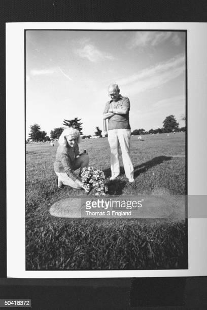 Surviving relatives of controversial baseball player Shoeless Joe Jackson niece Judy Bertram nephew Lee Jackson putting flowers at his grave