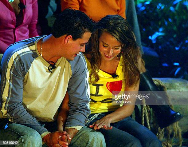 Survivor Allstar cast members Boston Rob Mariano and Amber Brkich look at Amber's engagement ring after Rob proposed marriage and Amber accepted on...