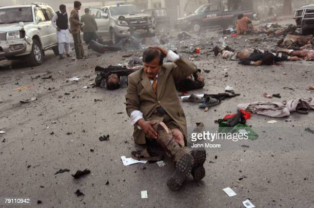 A survivor awaits evacuation immediately after a blast attack on former Prime Minister Benazir Bhutto on December 27 2007 in Rawalpindi Pakistan The...