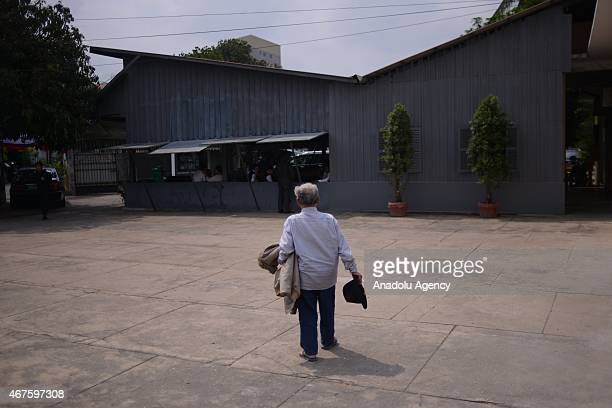 S21 survivor Bou Meng arrives to attend the inauguration ceremony of a new memorial stupa in the grounds of the former Khmer Rouge prison now a...