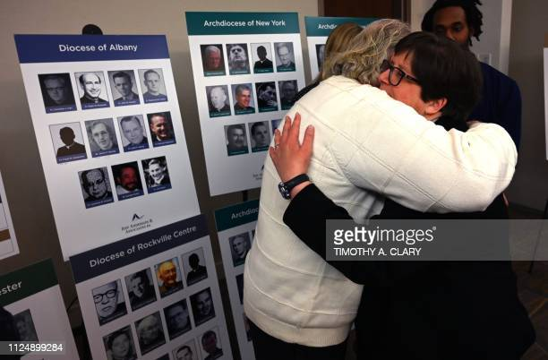 Survivor Bridget Lyons hugs a man after a press conference in New York February 14 to announce the filing of a lawsuit against the Catholic Church...