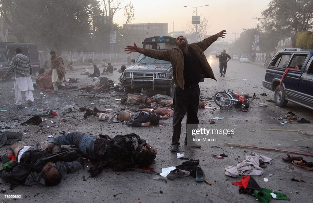 A survivor is overcome with emotion at the site of a bomb blast attack on former Prime Minister Benazir Bhutto on December 27, 2007 in Rawalpindi, Pakistan. The opposition leader has died from a bullet wound to the neck after speaking at a rally in the northern city where an estimated 15 people were left dead by the explosion, a party official and Bhutto's husband have been quoted as saying.