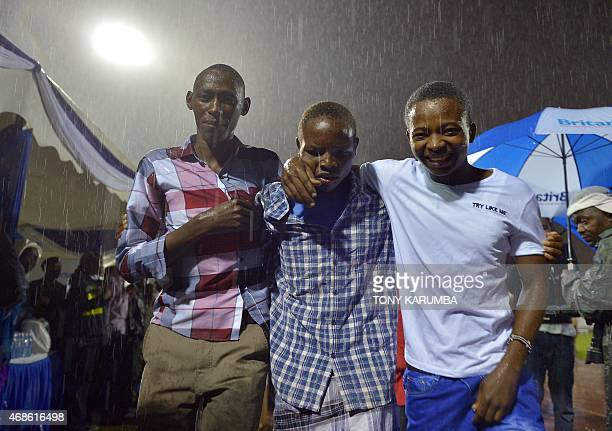 A survivor is reunited with relatives in Nairobi on April 4 after an attack by islamist gunmen claimed by alShabab on a university campus in Garissa...