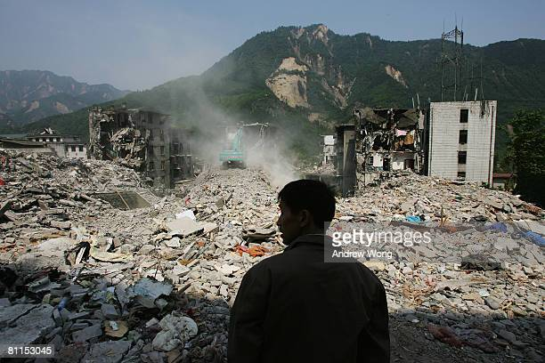 Survivor looks at the ruined residential area where he used to live May 19, 2008 in Shifang, Sichuan province, China. A major earthquake measuring...