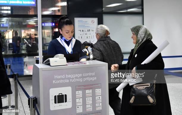 Survivor of Srebrenica 1995 massacre Fatima Gurdic arrives at passport control at Sarajevo International Airport early on November 20 2017 Gurdic and...