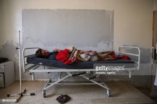 A survivor of the Assad regime's suspected chemical attack in Khan Shaykhun town of Idlib district waits to receive treatment at an hospital in Idlib...
