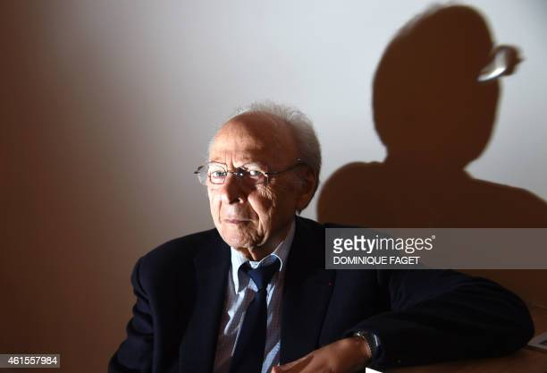 Survivor of the AuschwitzBirkenau Nazi concentration camp Henri Borlant poses in Paris on January 15 2015 before the presentation of the book Traces...