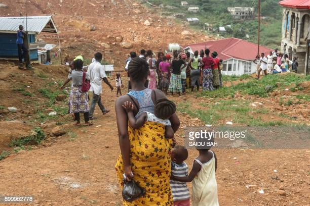 Survivor of the mudslide are seen walking in the affected area on November 15 2017 Four months after the landslides that killed her husband and more...