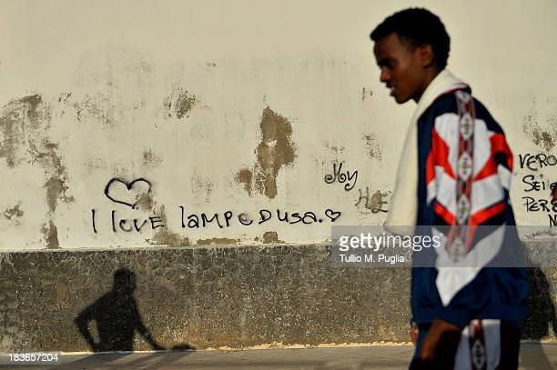 A survivor of the shipwreck off the Italian coast walk in the street of Lampedusa on October 8 2013 in Lampedusa Italy The search for bodies...