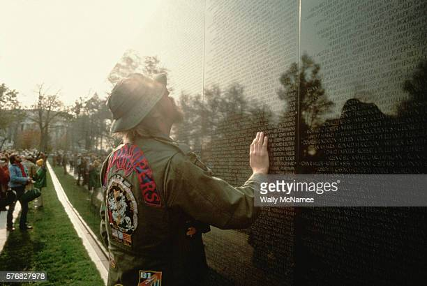 A survivor of The War In Vietnam searches the wall for the name of a fallen comrade in the days preceding the dedication of The Vietnam Veterans...