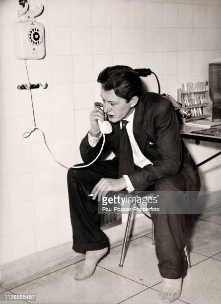 Survivor Peter Howard Daily Mail photographer on the telephone following the Munich Air Disaster in which 23 passengers died including 8 members of...