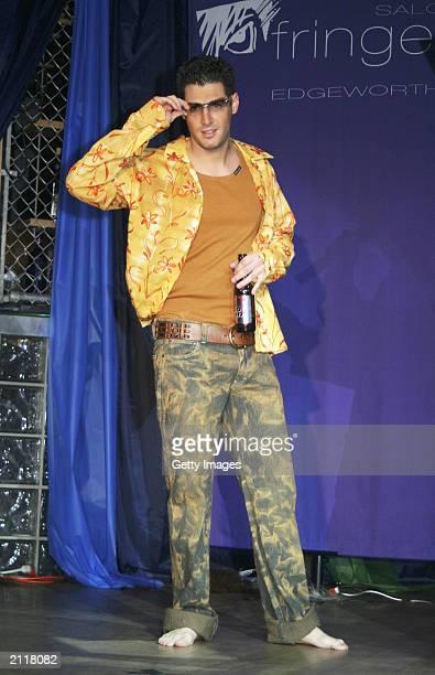 Survivor Rob Cesternino struts his stuff at the Festival of the Reality Superstars Fashion Show at the Joy Club June 26 2003 in Omaha Nebraska