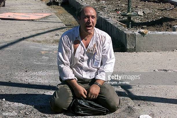 A survivor sits outside the World Trade Center after two planes hit the building September 11 2001 in New York City