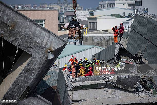 A survivor transported by rescue workers at a collapsed building on February 7 2016 in Tainan Taiwan A magnitude 64 earthquake hit southern Taiwan...