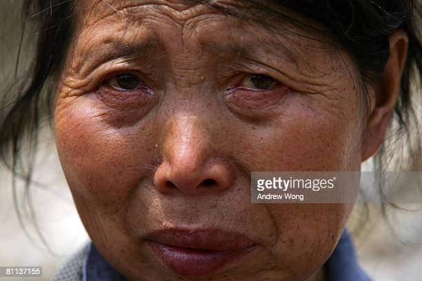 A survivor weeps after she escaped from earthquake stricken Yingxiu on May 18 2008 to safety in Zipingpu Sichuan province The death toll of the May...