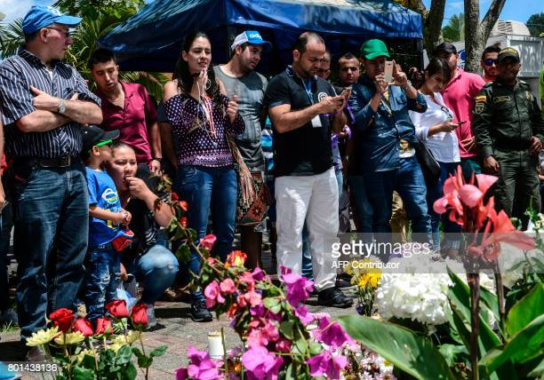 Survivors and locals place candels and flowers in tribute of the victims of the sank tourist boat 'Almirante' in the Reservoir of Penol in Guatape...
