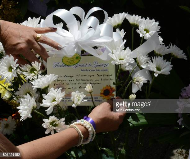 Survivors and locals place candels and flowers in tribute to the victims of the sank tourist boat 'Almirante' in the Reservoir of Penol in Guatape...