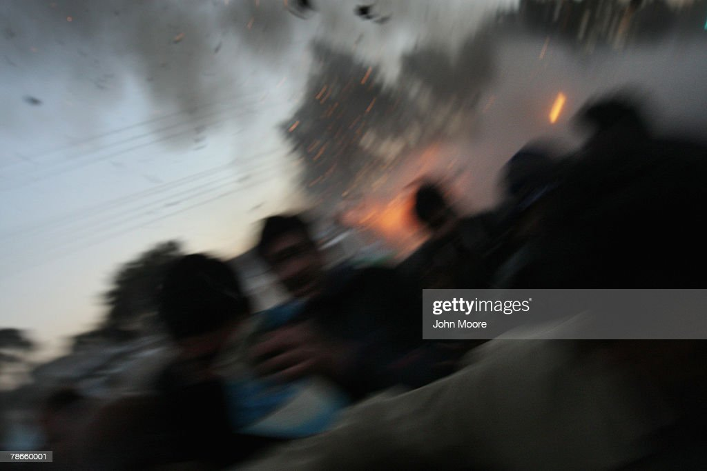 Survivors flee a bomb attack on former Prime Minister Benazir Bhutto on December 27, 2007 in Rawalpindi, Pakistan. The opposition leader has died from wounds to the neck and head after speaking at an election rally in the northern city where an estimated 20 people were left dead by the explosion, a party official and Bhutto's husband have been quoted as saying.