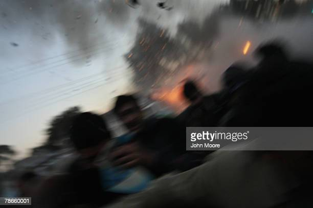 Survivors flee a bomb attack on former Prime Minister Benazir Bhutto on December 27 2007 in Rawalpindi Pakistan The opposition leader has died from...