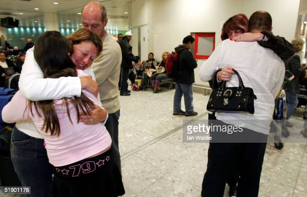 Survivors from the Asian tsunami disaster are reunited with their families as they arrive back at Heathrow airport on a flight from Bangkok December...