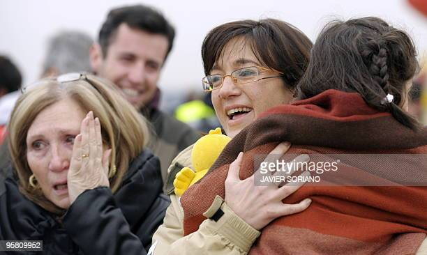 Survivors from the huge earthquake that devastated Haiti on January 12 are welcomed by relatives upon their arrival at Torrejon de Ardoz airport in...