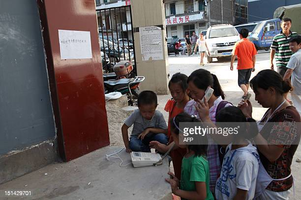 Survivors gather to make phone calls by a street in Yiliang, southwest China's Yunnan province on September 7 following two shallow quakes struck the...