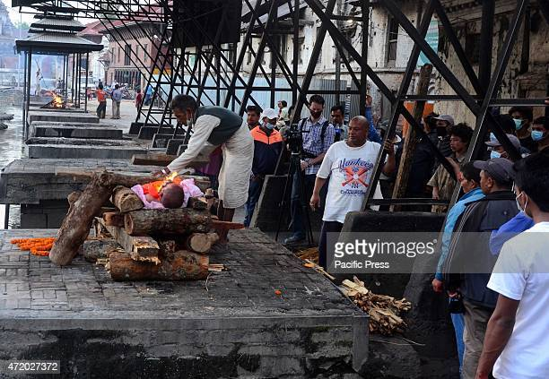 Survivors gathered to mourn and cremate relatives and friends killed in the worst earthquake in 80 years The famous Pashupatinath Ghat has become one...