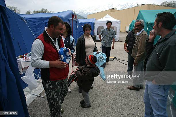 Survivors get on with daily life in the Monticchio tent camp on April 11 2009 in Monticchio next to Onna a village near L'Aquila Italy Easter weekend...