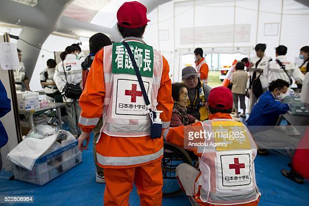 Survivors go through medical examinations in Kumamoto, Japan on April 21, 2016 . To date 45 people are confirmed dead and around 11,000 people have...