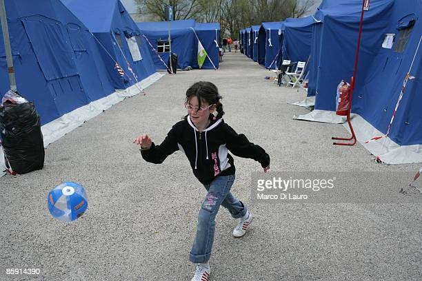 Survivors live their daily lives in the Monticchio tent camp on April 112009 in Monticchio next to Onna a village near L'Aquila Italy Easter weekend...