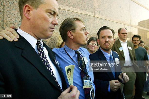 Survivors Network of Those Abused by Priests members Lee White David Clohessy and Mark Serrano talk with the media after the vote in favor to bar...