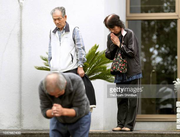 Survivors observe a minute of silence at an evacation center a week after the magnitude 67 earthquake on September 13 2018 in Atsuma Hokkaido Japan...
