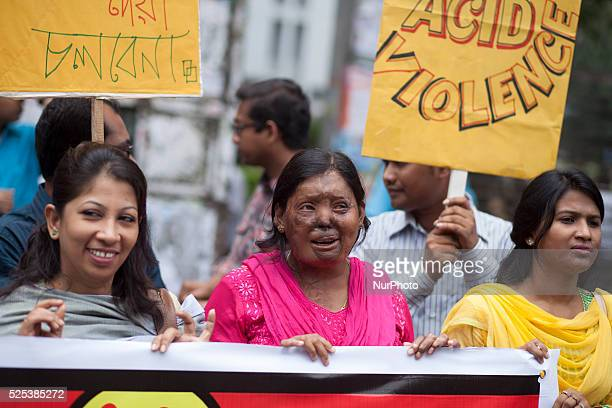 Survivors of acid attacks attend a human chain to protest acid attacks and torture of women in Dhaka on 12th May 2015 According to Acid Survivors...