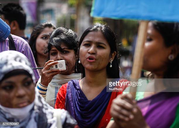 Survivors of acid attacks attend a human chain to protest against acid violence on the eve of the International Women's Day celebration in Dhaka...