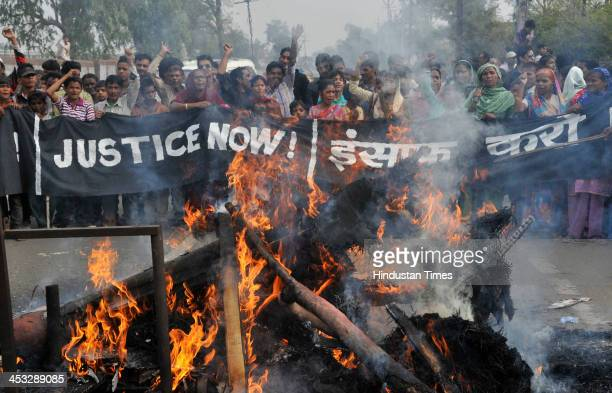 Survivors of Bhopal Gas Disaster and activists of various gas victim organizations burn effigy and hold a protest against Dow Chemical on 29th...