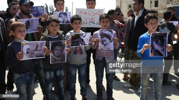 Survivors of chemical gas attack gather to protest Assad regime at the Khan Shaykhun town's square in Idlib Syria on April 7 2017 Assad regime...