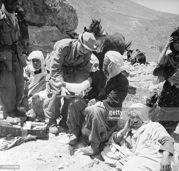 Survivors of Moslem Massacre Melouza Algeria Medical aid brought in by French troops reaches some of the very vew male survivors of last week's...