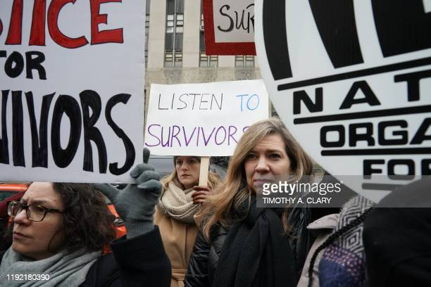 Survivors of sexual abuse gather outside the courthouse before the arrival of Harvey Weinstein at the State Supreme Court in Manhattan January 6,...