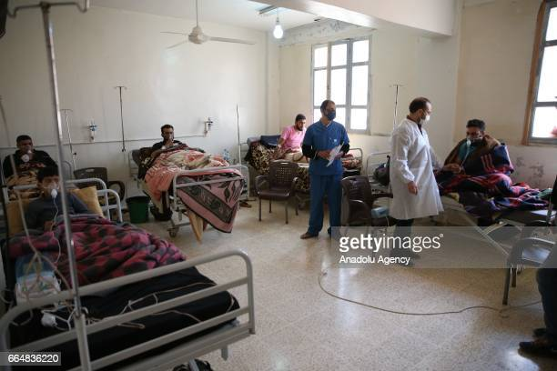 Survivors of the Assad regime's suspected chemical attack in Khan Shaykhun town of Idlib district receive treatment at an hospital in Idlib Syria on...