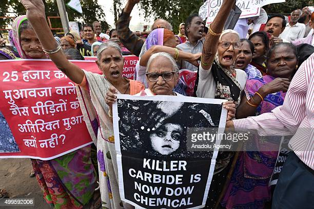 Survivors of the Bhopal Gas Disaster where a gas leak from a Union Carbide pesticide plant killing thousands of people stage a protest demanding...