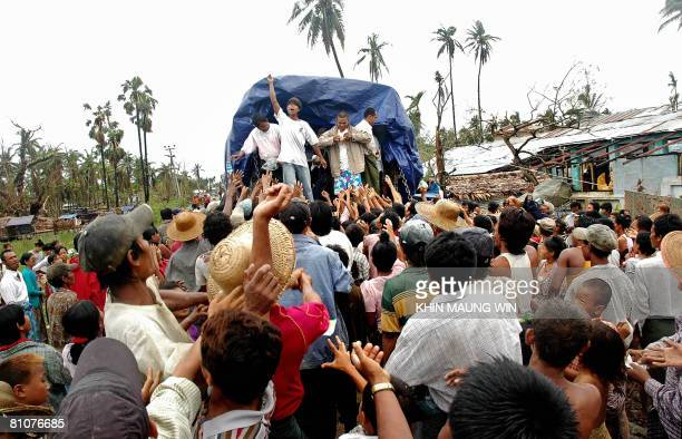 Survivors of the cyclone Nargis queue behind a truck in hope to get relief food in Bogalay on May 13 2008 The United Nations warned on May 13 that...