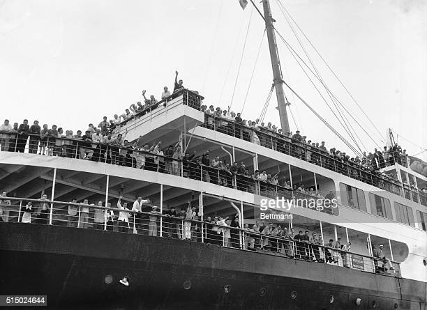 Survivors of the Italian luxury liner Andrea Doria crowd the rails of the liner Ile de France as it nears New York Harbor today after taking part in...
