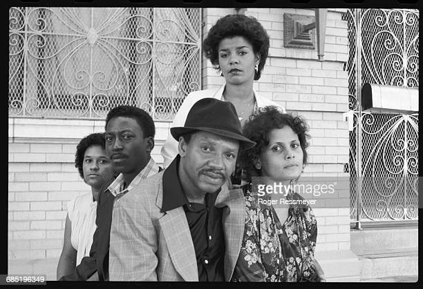 Survivors of the Jonestown massacre sit outside the old People's Temple on Geary Blvd. From left to right: Sandra Evans, Julius Evans, Richard Clark,...