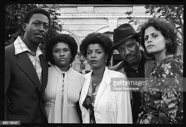 Survivors of the Jonestown massacre sit outside the old People's Temple on Geary Blvd. From left to right: Julius Evans, Sandra Evans, Leslie...