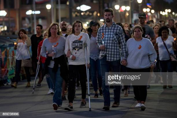 Survivors of the Las Vegas mass shooting and community members gather for a procession in memory of the victims of the Las Vegas mass shooting in...