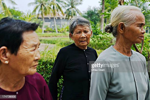 Survivors of the My Lai massacre from right Pham Thi Thuan Ha Thi Quy and Truong Thi Le tour the site where the massacre took place Mrs Ha's mother a...