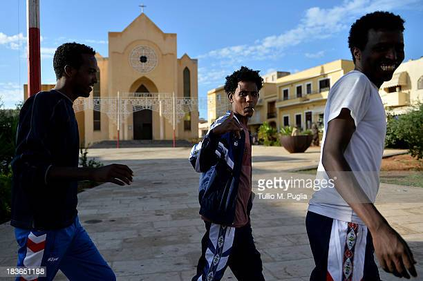 Survivors of the shipwreck off the Italian coast walk in the street of Lampedusa on October 8 2013 in Lampedusa Italy The search for bodies continues...