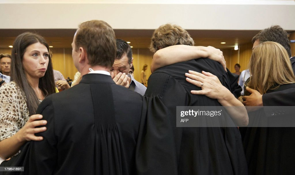 Survivors respond to the ruling of the Supreme Court that the Netherlands is responsible for the deaths of three Muslim men after the fall of the Srebrenica enclave in 1995, on September 6, 2013 in The Hague. The Dutch state is responsible for sending three Bosnian Muslims to their deaths when they were expelled from a UN compound at Srebrenica in 1995, the supreme court ruled today. The final ruling in the long-running case means that former UN interpreter Hasan Nuhanovic, whose father, mother and brother were killed by Bosnian Serb forces after Dutch peacekeepers expelled them from the UN base, can seek compensation from the Dutch state.